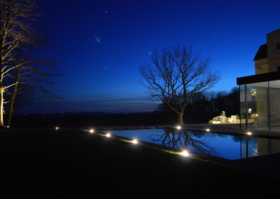 outdoor lighting installed around swimming pool
