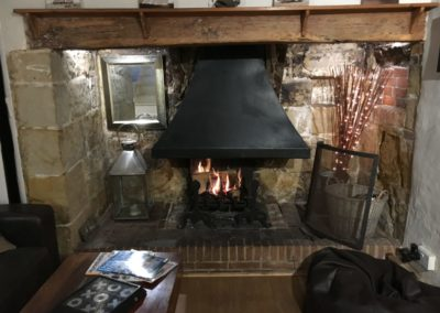 removed old wood burner and chimney, installed open fire and hood