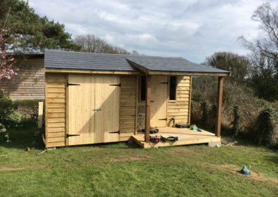 bespoke out buiding to our design, split roof, office to one side, storage space to the other