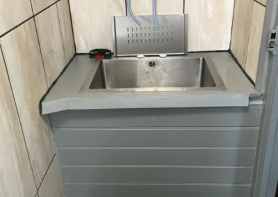 new sink fitted in industrial toilet