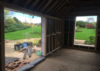 opening up walls for bi-fold doors and sheet glass window